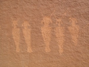 Five figures from a very large panel. Center figure is about 20 cm overall.