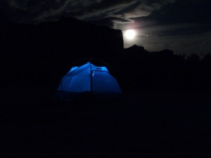 Long exposure of tent at night. We have a string of solar lights we use in the tent on the river which light it up well. Moon is near full, Jupiter is also visible.