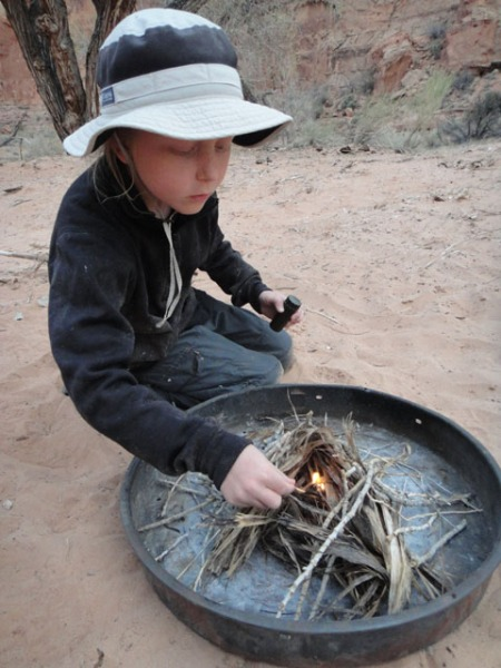 Nciolai Trainor starting our nightly fire in the fire pan. Photo by Gerald Trainor.
