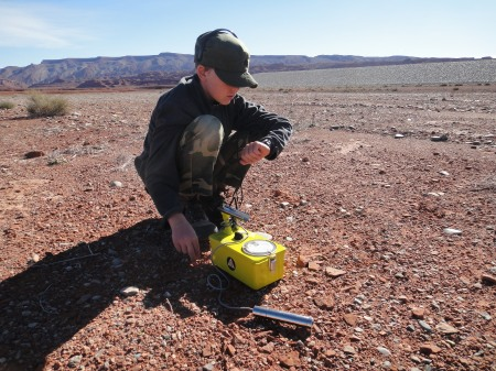 Nicolai conducting radiation survey near Halchita, Utah. Photo by Gerals Trainor.