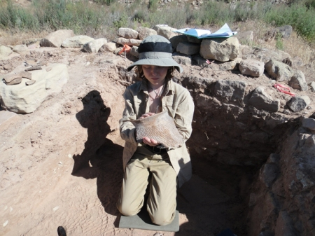 The young archaeologist at work. Nancy Patterson Village, Mesa Verde corrugated sherd being removed. Photo by Gerald Trainor.